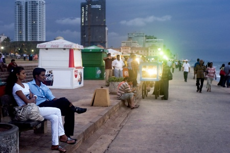 Colombo,Sri Lanka - February 22,2011: Quay in Colombo in the evening, with strolling  along the coast couples
