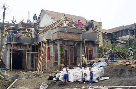 residential district: Sukapura, Indonesia - April 23, 2011: Construction activity of a building in small Indonesian village Editorial