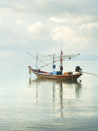 tourquoise: Traditional thailand boat  in the sea at sunrise