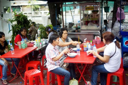 Bangkok, Thailand - March 27, 2011: Traditional thai fast food on Bangkok street