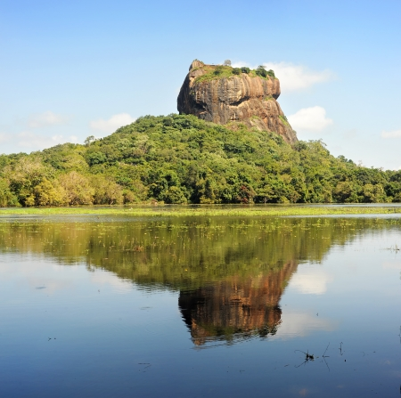 renowned: Sigiriya (Lions rock) is an ancient rock fortress and palace ruin of Sri Lanka, surrounded by the remains of an extensive network of gardens, reservoirs, and other structures. A popular tourist destination, Sigiriya is also renowned for its ancient paint Stock Photo