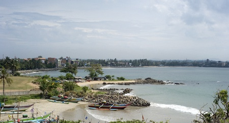 galle: Skyline of Galle with beautiful beach and fishing boats. Sri Lanka