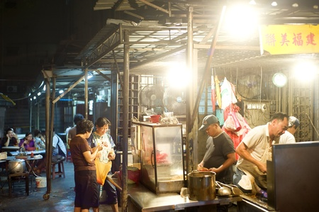 stall: Kuala Lumpur, Malaysia - March 30, 2011: Street fast food in Kuala Lumpurs China Town at night. Editorial