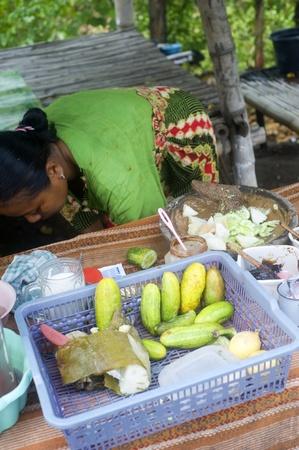 capacitance: Java,Indonesia-April 21,2011:A   woman selling fast food on the   Java island Editorial