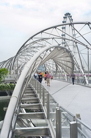 Singapore ,Republic of Singapore - May 2, 2011: The Helix Bridge , previously known as the Double Helix Bridge , is a pedestrian bridge linking Marina Centre with Marina South in the Marina Bay area in Singapore