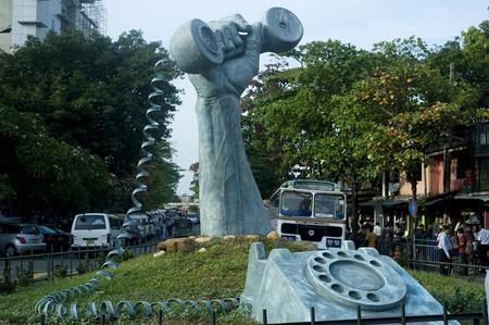 Colombo, Sri Lanka -  February 22,2011: Statue of a phone in a hand, Colombo, Sri Lanka Stock Photo - 10938534