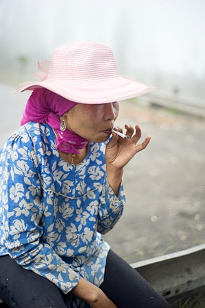 Probolingo, Indonesia - April 24,2011: Unidentified indonesian woman smoking  cigarette. Smoking in Indonesia is a common practice, as over 165 million people smoke in Indonesia. Of Indonesian people, 63% of men and 5% of women reported as smokers, a tota