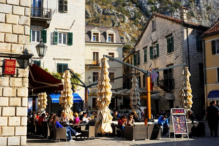 Kotor, Montenegro - November 3, 2011: Street cafe in Kotor old town. Kotor has one of the best preserved medieval old towns in the Adriatic and is a UNESCO world heritage site.