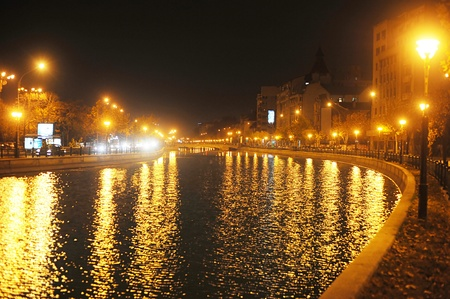 bucuresti: Bucharest, Romania - November 7, 2011: Dambovita river  in the center of Bucharest at night. Romania Editorial