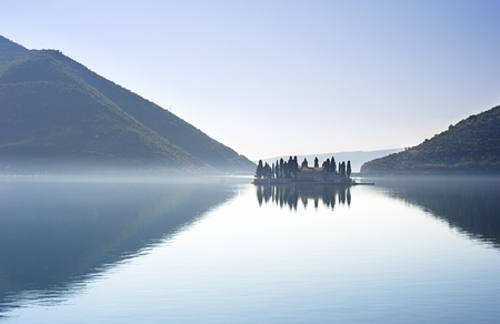 islets: Ostrvo Sveti Dorde ( Island of Saint George) is one of the two islets off the coast of Perast in Bay of Kotor, Montenegro Stock Photo