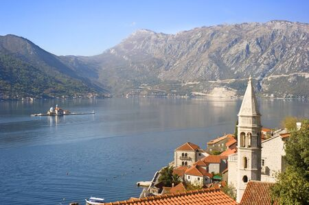 Aerial view on town Perast with Church Our Lady of the rocks and cruise liner. Montenegro photo