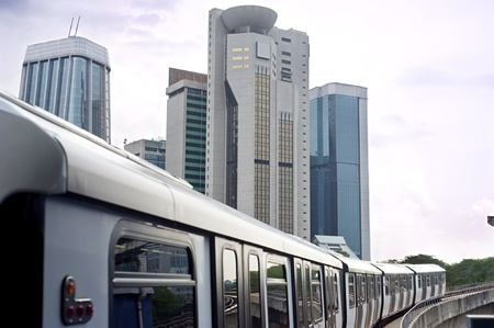Cityscape with metro and high office buildings in Kuala Lumpur, Malaysia