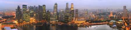 Panorama of Singapore from Marina Bay Sand Resort at beautiful sunset  photo