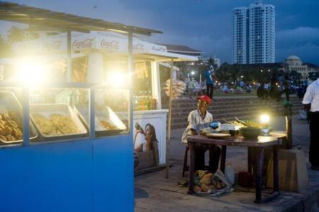 Colombo,Sri Lanka - February 22,2011: Traditional fast food on the quay of Colombo