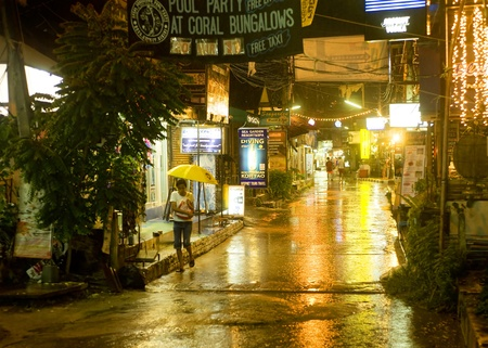 Koh Phangan, Thailand - March 22, 2011: Night street in the rain on Koh Phangan island. It is famous for its full moon party at Haad Rin Beach and as a backpackers destination. Area: about 168 km? with population about 12000 people