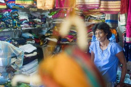 Hikkaduwa, Sri Lanka - January 24, 2011: Portrait of a Sri Lankan tailor in her workshop.