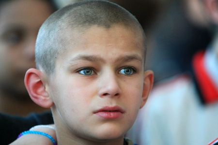 Kiev, Ukraine - February 21, 2008: Unidentified boy at Shelter for Minors. Of Ukraine's nine million children some 65,000 live in state-run children's institutions such as orphanages, boarding schools and shelters.