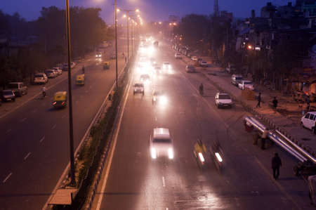 Delhi, India - February 29, 2012: Traffic  on the road at night  in Delhi. As of 2011, India has a total of 70,934 km (44,076 mi) of National Highways, of which 200 km (124 mi) are classified as expressways