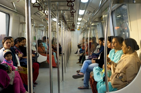 mi: Delhi, India - February 03, 2012:  Women-Only Subway Cars  in Delhi. Delhi Metro network consists of six lines with a total length of 189.63 kilometres (117.83 mi) with 142 stations