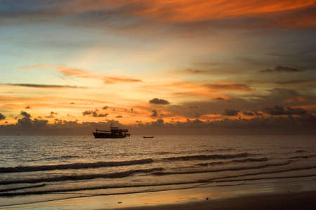 Thailand fishing boat at a beautiful sunset photo