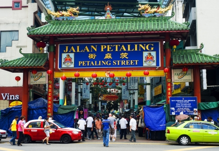 Kuala Lumpur, Malaysia - March 20, 2012: Petaling Street in Kuala Lumpur . The street is a long market which specialises in counterfeit clothes, watches and shoes. Famous tourist attraction  Stock Photo - 12993760