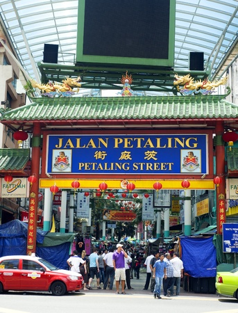 Kuala Lumpur, Malaysia - March 20, 2011: Petaling Street in Kuala Lumpur . The street is a long market which specialises in counterfeit clothes, watches and shoes. Famous tourist attraction