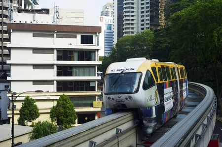 Kuala Lumpur, Malaysia - Marсh 20, 2012: Monorail train arrives at a train station. Kuala Lumpur metro consists of 6 metro lines operated by 4 operators.  Stock Photo - 12993758