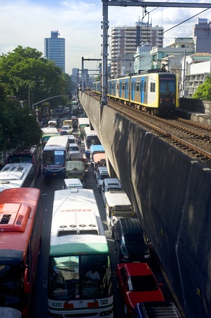 manila: Manila, Philippines - April 02, 2012: LRT train arrives at a train station. LRT serves 579,000 passengers each day. Its 31 stations along over 31 kilometers (19 mi) of mostly elevated track form two lines