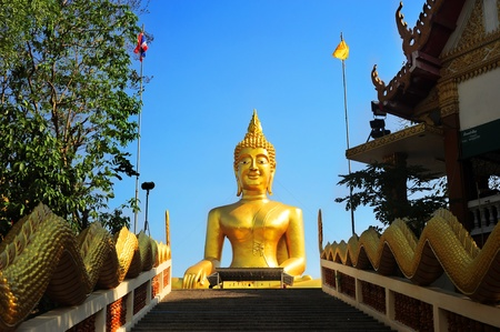The figure of a large golden sitting Buddha is in Pattaya, Thailand.