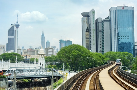 Kuala Lumpur, Malaysia - March 20, 2012: LRT train arrives at a train station in Kuala Lumpur. Kuala Lumpur metro consists of 6 metro lines operated by 4 operators.