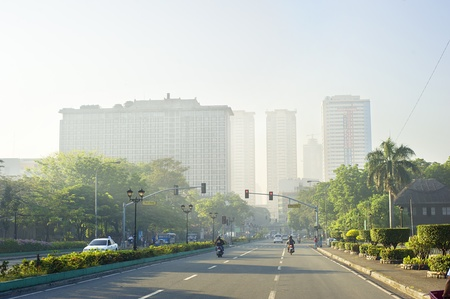 populous: Metro Manila, Philippines -  April 01, 2012: Morning traffic on the street  in  Manila. Metro Manila is the most populous metropolitan area in the Philippines with an estimated population of 16,300,000