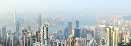 hk: Panorama of Hong Kong from Victoria bay at sunset.