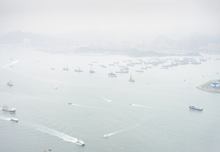 tonnes: Seaport in Hong Kong . Some 456,000 vessels arrived in and departed from Hong Kong during the year, carrying 243 million tonnes of cargo