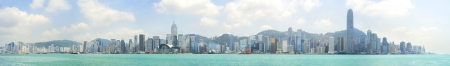 panoramic business: Hong Kong - May 21, 2012: Hong Kong panorama. With a land mass of 1,104 km and population of 7 million people, Hong Kong is one of the most densely populated areas in the world