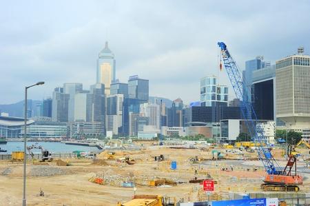 taller: Hong Kong - May 21, 2012: Construction site in  Hong Kong. Hong Kong is an international financial centre that has 112 buildings that stand taller than 180 metres. Editorial