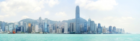 Skyline of Hong Kong island from Kowloon bay in the sunshine day photo