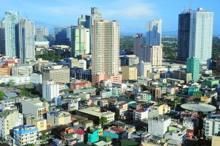 slum: Aerial view on Makati - is one of the 17 cities that make up Metro Manila. Philippines