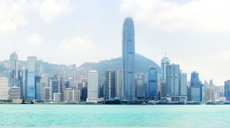 Skyline of Hong Kong island from Kowloon bay in the sunshine day Stock Photo - 15317483