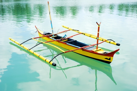 Banca - traditional Philippines boat. Calicoan island, Philippines photo