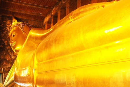 Reclining Buddha at Wat Pho, Bangkok, Thailand photo