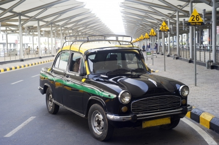 Old fashioned taxi at Indira Gandhi International Airport photo