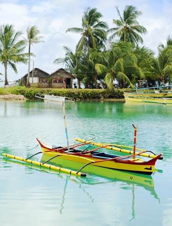 philippines: Tropical landscape with traditional Philippines boats and village on Calicoan island, Philippines Stock Photo