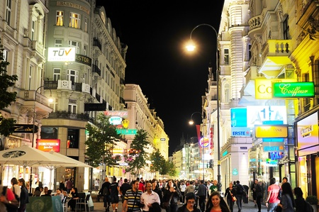 stephansplatz: Vienna, Austria - September 23, 2012: Vienna city centre with many tourists at night . Tourism generated 8.4% of Austrian gross domestic product (23.6 billion Euros) and provided 181 thousand jobs Editorial