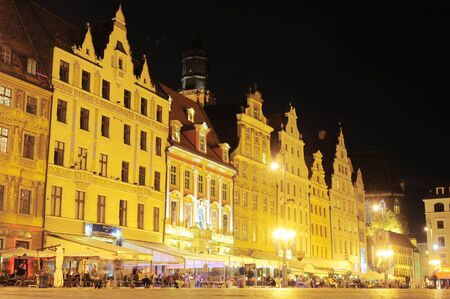 Wroclaw, Poland -  September 08, 2012 : Market square with many tourists in Old Town of Wroclaw, . About 15 million tourists visit Poland every year. Stock Photo - 15943030