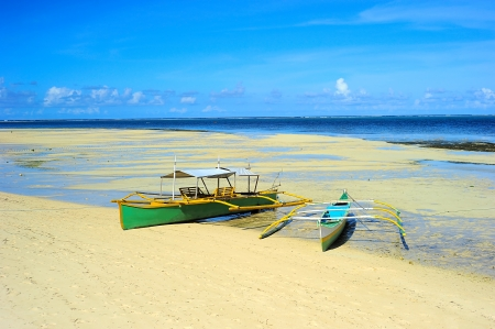 Traditional Philippines boats on the beach during the low tide on Shiargao island, Philippines Stock Photo - 16707327
