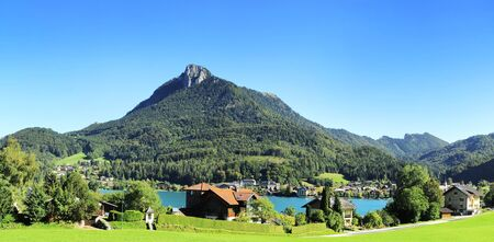 Village near the lake in the Alps mountains. Austria photo