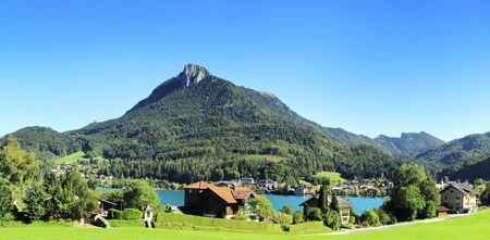 european alps: Village near the lake in the Alps mountains. Austria Stock Photo