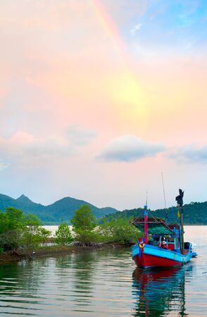 exporter:  Fishermans boat returning to home from fishing. Thailand is the worlds leading producer and exporter of shrimp products. Stock Photo