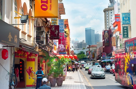 kuala lumpur: Kuala  lumpur, Malaysia - March 20, 2012: Busy Chinatown street in KL. Kuala Lumpur is the capital and most populous city in Malaysia.The city covers an area of 243 km2 and has  population of 1.6 million as of 2012