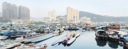 dweller: Aberdeen is famous to tourists for its floating village and floating seafood restaurants. Hong Kong Stock Photo